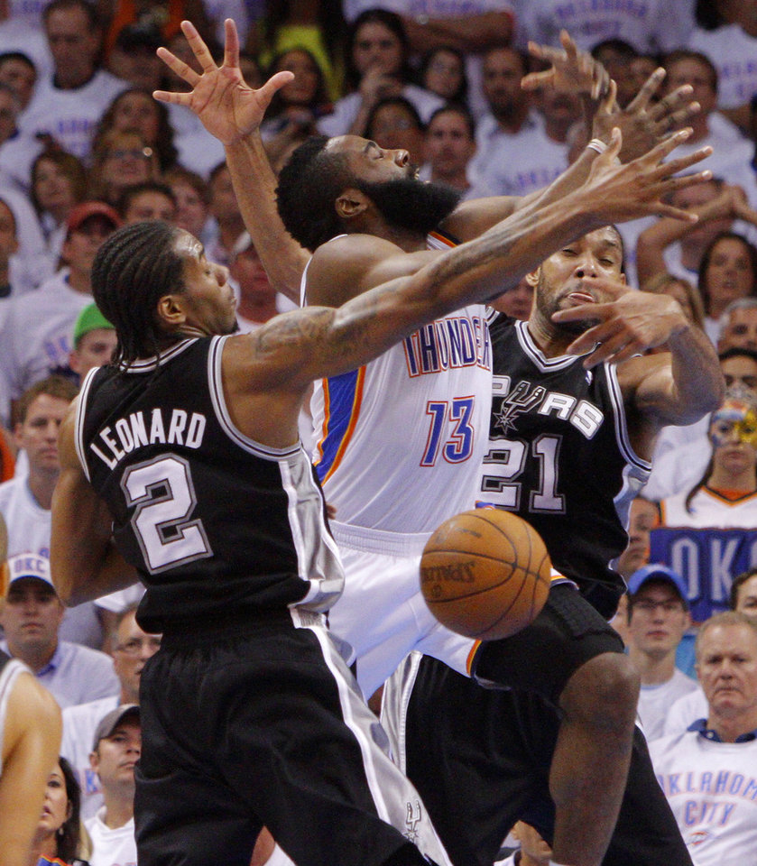 Photo - Oklahoma City's James Harden (13) loses the ball between San Antonio's Kawhi Leonard (2) and Tim Duncan (21) during Game 6 of the Western Conference Finals between the Oklahoma City Thunder and the San Antonio Spurs in the NBA playoffs at the Chesapeake Energy Arena in Oklahoma City, Wednesday, June 6, 2012. Photo by Bryan Terry, The Oklahoman