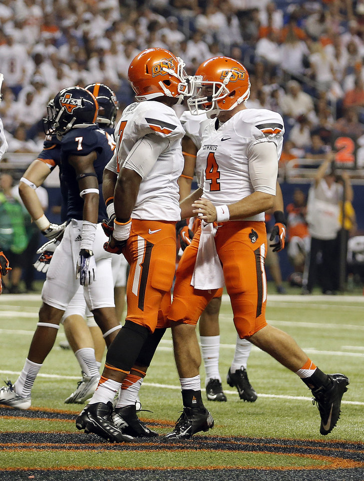 Oklahoma State's Brandon Sheperd (7) and J.W. Walsh (4) celebrate a touchdown  during the first half of a college football game between the University of Texas at San Antonio Roadrunners (UTSA) and the Oklahoma State University Cowboys (OSU) at the Alamodome in San Antonio, Saturday, Sept. 7, 2013.  Photo by Sarah Phipps, The Oklahoman