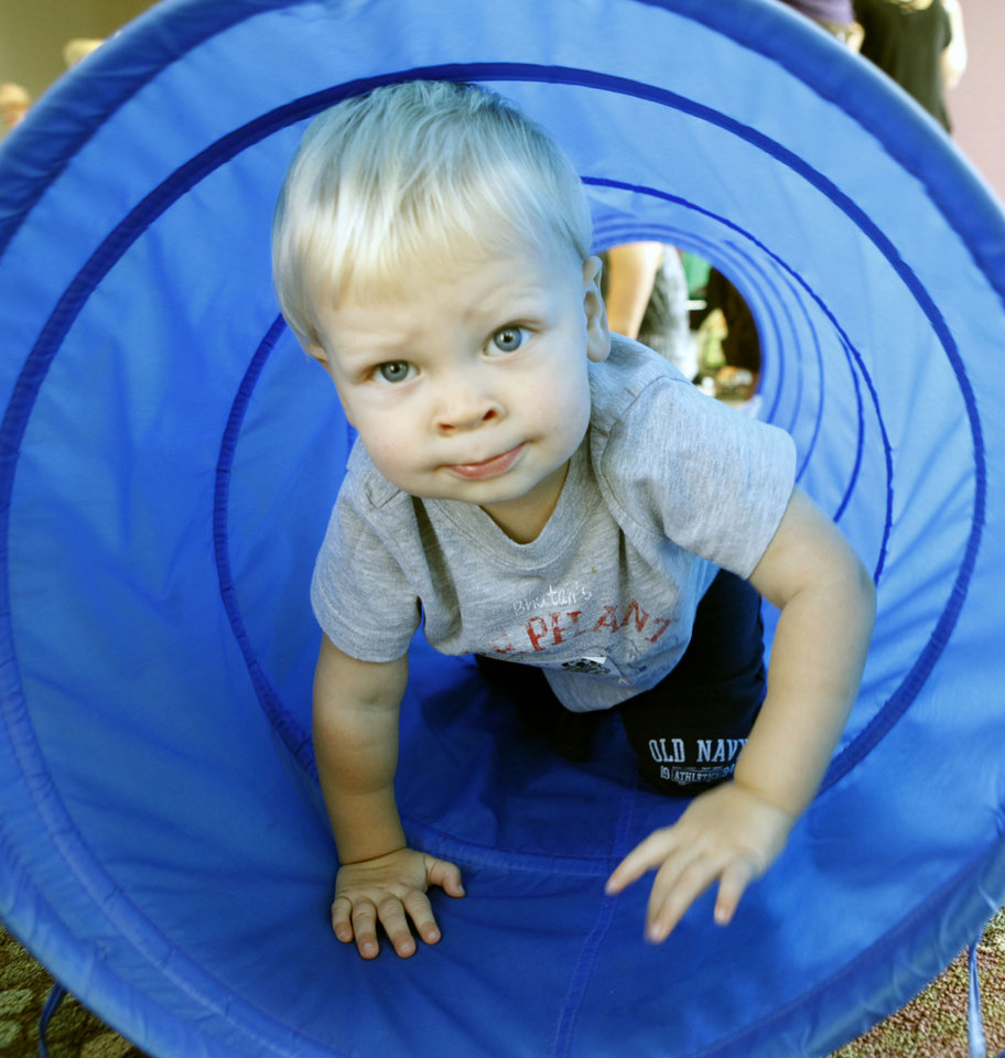 "17-month-old Connor Nevitt emerges from a tunnel during ""Playtime for Toddlers"" at the Edmond Library in Edmond, OK, Tuesday, Aug. 31, 2010. By Paul Hellstern, The Oklahoman"