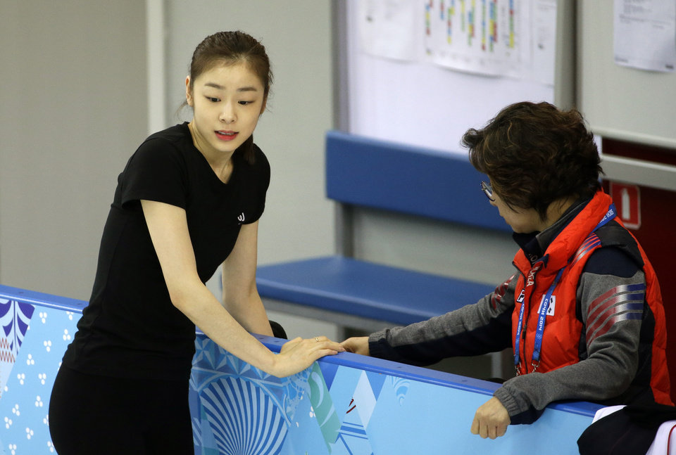 Photo - Yuna Kim of South Korea rests against the railing during a practice session at the figure skating practice rink at the 2014 Winter Olympics, Tuesday, Feb. 18, 2014, in Sochi, Russia. (AP Photo/David Goldman)