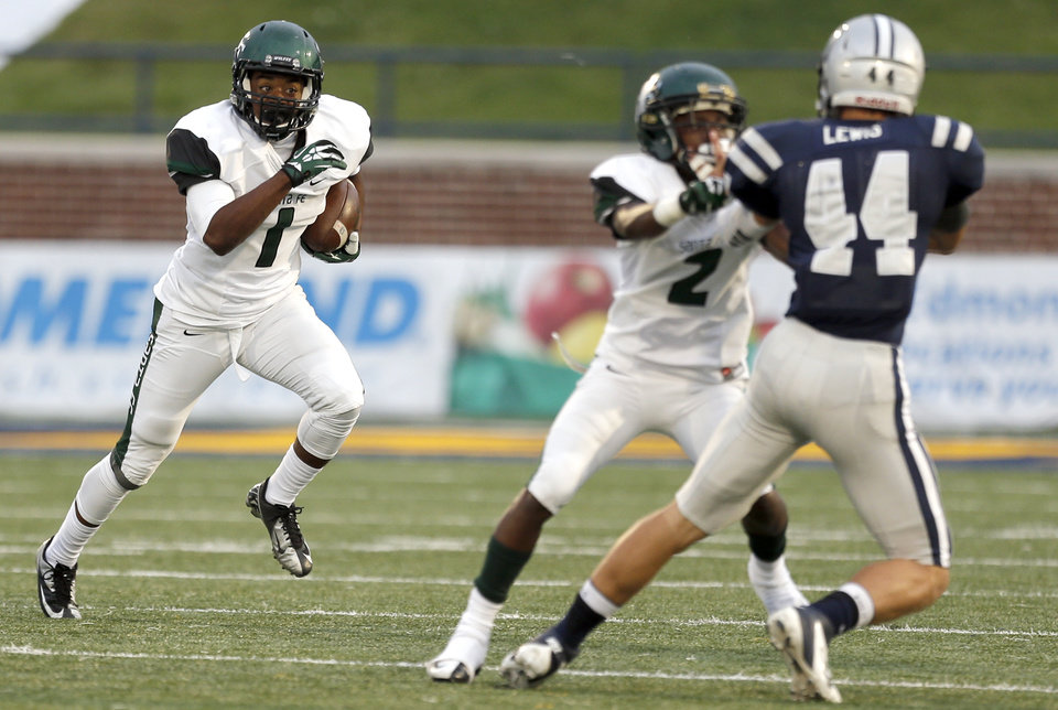 Photo - Edmond Santa Fe's Cameron Westbrook looks to run up field during the high school football game between Edmond North High School and Edmond Santa Fe High School at Wantland Stadium in Edmond, Okla.,  Friday, Sept. 20, 2013. Photo by Sarah Phipps, The Oklahoman