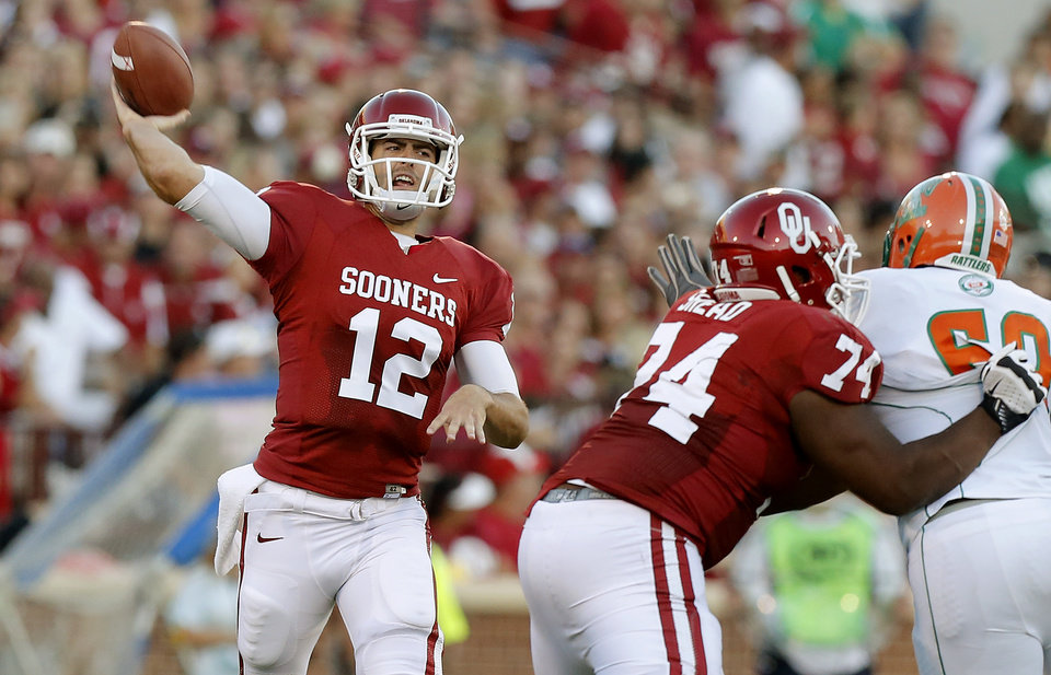 Photo - Oklahoma's Landry Jones (12) throws the ball during the college football game between the University of Oklahoma Sooners (OU) and Florida A&M Rattlers at Gaylord Family—Oklahoma Memorial Stadium in Norman, Okla., Saturday, Sept. 8, 2012. Photo by Bryan Terry, The Oklahoman