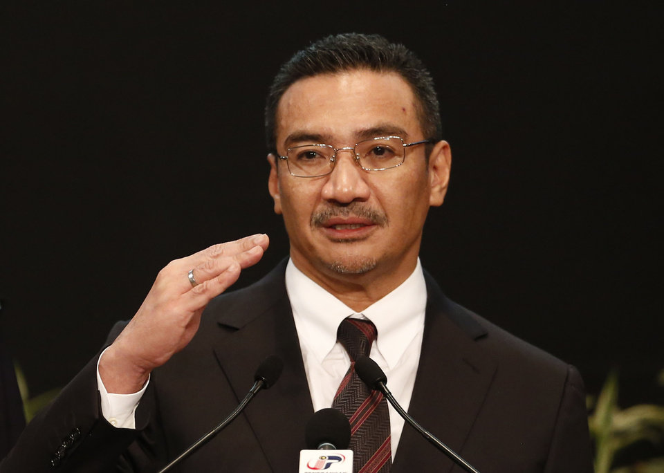 Photo - Malaysia's acting Transport Minister Hishammuddin Hussein answers a reporter's questions during a press conference for the missing Malaysia Airline, flight MH370, at Putra World Trade Centre (PWTC) in Kuala Lumpur, Malaysia, Tuesday, March 25, 2014. China demanded that Malaysia turn over the satellite data used to conclude that a Malaysia Airlines jetliner had crashed in the southern Indian Ocean, killing everyone on board, as gale-force winds and heavy rain on Tuesday halted the search for remains of the plane. (AP Photo/Vincent Thian)