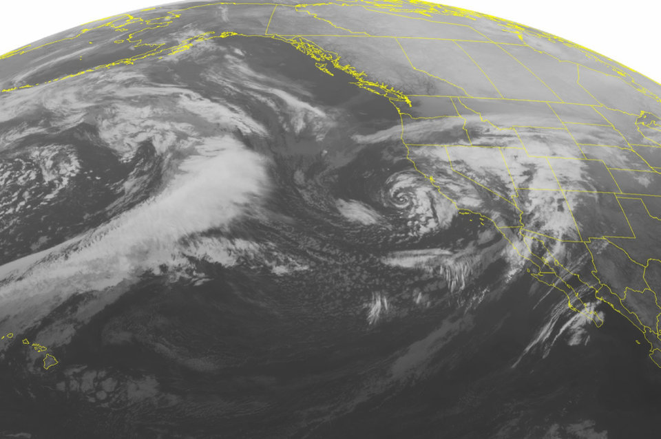 Photo - This NOAA satellite image taken Saturday, March 1, 2014 at 2:00 AM EST shows a large mature storm off the coast of California. This storm is giving well needed rain to Southern California. Most of the weather in the west is being controlled by the storm. Its associated fronts are extending out from the center giving heavy rain and snow to Utah and Nevada along with other Rocky Mountain states. (AP PHOTO/WEATHER UNDERGROUND)