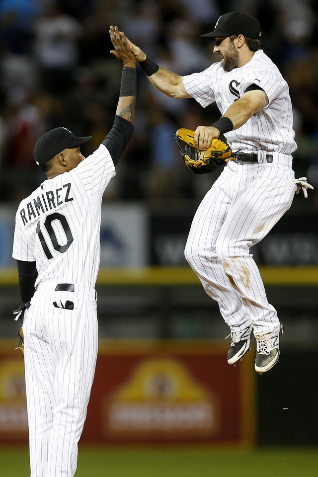 Photo - Chicago White Sox center fielder Adam Eaton, right, and shortstop Alexei Ramirez, left, celebrate after defeating the San Francisco Giants 8-2 in a baseball game on Tuesday, June 17, 2014, in Chicago. (AP Photo/Andrew A. Nelles)