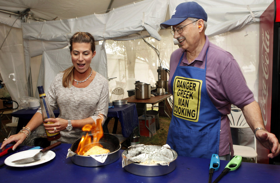 Irene Gianos, left, and Andy Dantes make saganaki, a Greek appetizer commonly referred to as flaming cheese.  It is made with kasseri cheese. Gianos and Dantes are long-time members of St. George Church. Members of St. George's Greek Orthodox Church and community volunteers are sponsoring this years Greek Festival of Oklahoma City. The festival includes food, dancing and an introduction to Greek culture at the church, NW 145 and N. Pennsylvania  on Saturday, Sep. 15, 2012,  Photo by Jim Beckel, The Oklahoman.