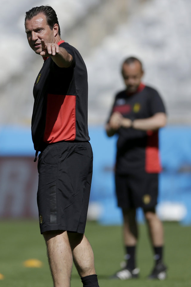 Photo - Belgium head coach Marc Wilmots points while standing on the pitch at the start of a training session at the Mineirao Stadium in Belo Horizonte, Brazil, Monday, June 16, 2014.  Belgium will play in group H of the Brazil 2014 soccer World Cup.  (AP Photo/Bruno Magalhaes)
