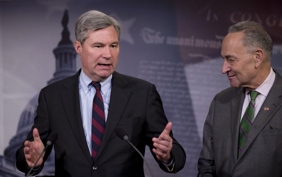Photo - Sen. Sheldon Whitehouse, D-R.I. left, accompanied by Sen. Charles Schumer, D-N.Y., speaks to reporters on Capitol Hill in Washington, Wednesday, April 2, 2014, about the Supreme Court decision in the McCutcheon vs. FEC case, in which the Court struck down limits in federal law on the aggregate campaign contributions individual donors may make to candidates, political parties, and political action committees.  (AP Photo/Manuel Balce Ceneta)