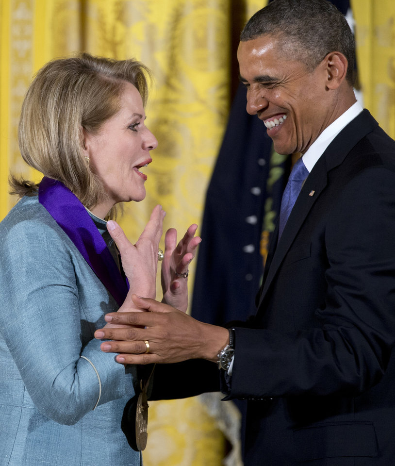 Photo - President Barack Obama awards Renée Fleming the 2012 National Medal of Arts for her contributions to American music during a ceremony in the East Room of White House in Washington, Wednesday, July 10, 2013.  (AP Photo/Carolyn Kaster