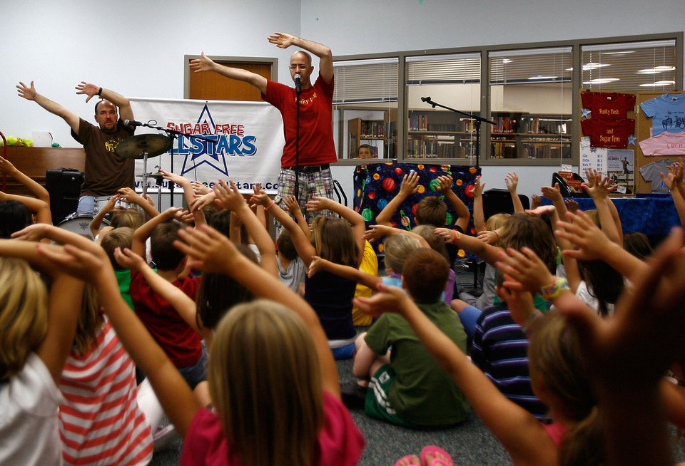 "Chris ""Boom!' Wiser, right, and Rob ""Dr. Rock"" Martin perform a 2010 show as the Sugar Free Allstars at the Yukon Library.Photo by Mitchell Alcala, The Oklahoman Archives. <strong>Mitchell Alcala - The Oklahoman</strong>"