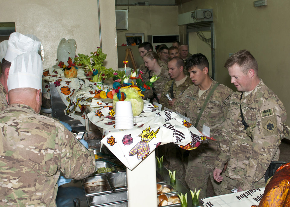 LAGHMAN PROVINCE, Afghanistan - This Thanksgiving, members of the 45th Infantry Brigade Combat Team stationed at Forward Operating Base Gamberi, were able to enjoy the traditional meal with their military family and friends for both lunch and dinner. Officers and senior enlisted volunteered to serve lunch.   U.S. Army photo by Maj. Lindy White, Task Force Thunderbird Public Affairs