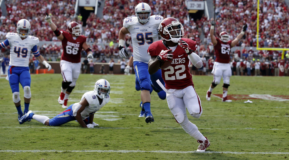Photo - Oklahoma's Roy Finch (22) scores during the first half of a college football game between the University of Oklahoma Sooners (OU) and the Tulsa Golden Hurricane (TU) at Gaylord Family-Oklahoma Memorial Stadium in Norman, Okla., on Saturday, Sept. 14, 2013. Photo by Steve Sisney, The Oklahoman