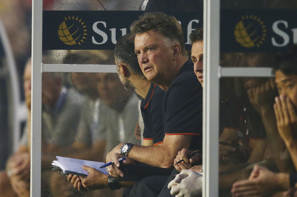 Photo - Manchester United Louis Van Gaal watches first half game action against Liverpool during the finals of the Guinness International Championship Cup soccer match in Miami, Gardens, Fla., Monday, July 4, 2014. (AP Photo/J Pat Carter)