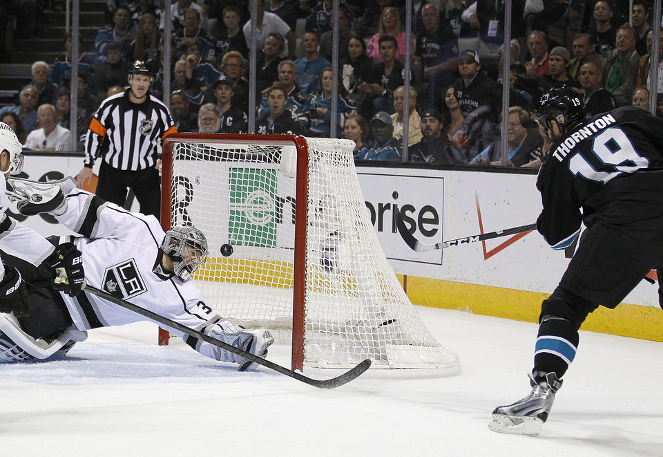 San Jose Sharks center Joe Thornton (19) scores a goal past Los Angeles Kings goalie Jonathan Quick (32) during the first period in Game 6 of their second-round NHL hockey Stanley Cup playoff series in San Jose, Calif., Sunday, May 26, 2013. (AP Photo/Tony Avelar)