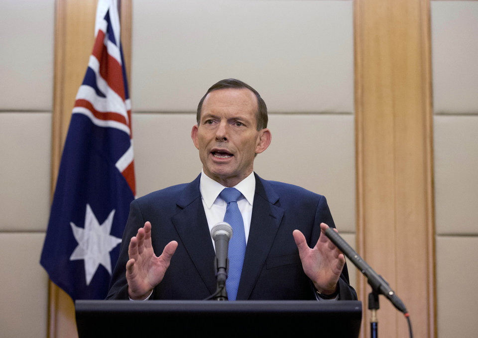 Photo - Australian Prime Minister Tony Abbott speaks during a press conference at a hotel in Beijing, China Saturday, April 12, 2014. Abbott told Chinese President Xi Jinping during their meeting on Friday that he was confident signals heard by an Australian ship towing a U.S. Navy device that detects flight recorder pings are coming from the missing Malaysian Airlines Flight 370. Officials believe the plane flew off course for an unknown reason and went down in the southern Indian Ocean off the west coast of Australia. (AP Photo/Andy Wong)