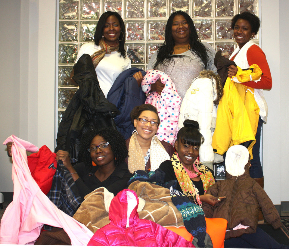 Oklahoma State University-Oklahoma City's Black Student Association members who helped with a coat donation project included, from top left, Kynyatta Jolly, Rashida Jones and Tehryn Jones. Bottom row from left are Darrishae Potts,  D'Andrea Irby and Lakisha Holland. PHOTO PROVIDED BY Oklahoma State University-Oklahoma City