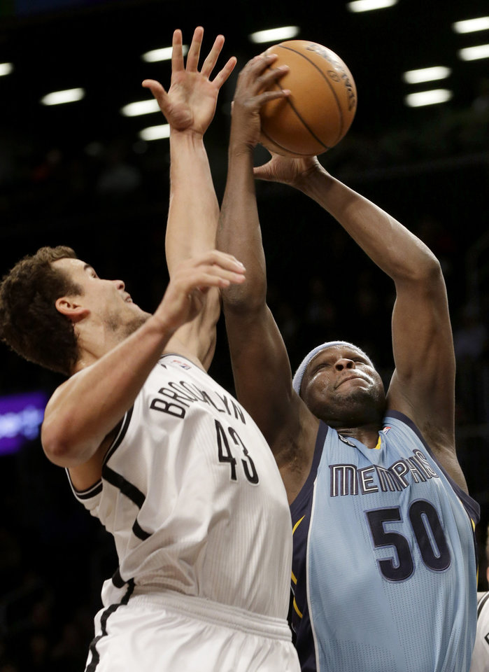 Memphis Grizzlies' Zach Randolph, right, fights for a rebound with Brooklyn Nets' Kris Humphries during the first half of the NBA basketball game at the Barclays Center Sunday, Feb. 24, 2013 in New York.  (AP Photo/Seth Wenig)