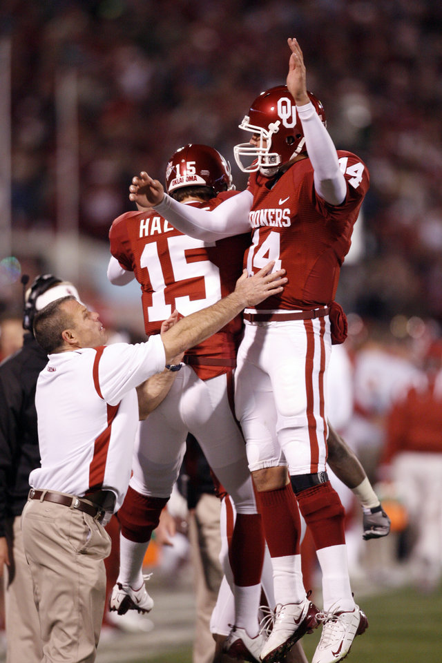 OU quarterback Sam Bradford gets a bump from Joey Halzle after a touchdown during the first half of the college football game between the University of Oklahoma Sooners and Texas Tech University at the Gaylord Family -- Oklahoma Memorial Stadium on Saturday, Nov. 22, 2008, in Norman, Okla.   BY STEVE SISNEY, THE OKLAHOMAN