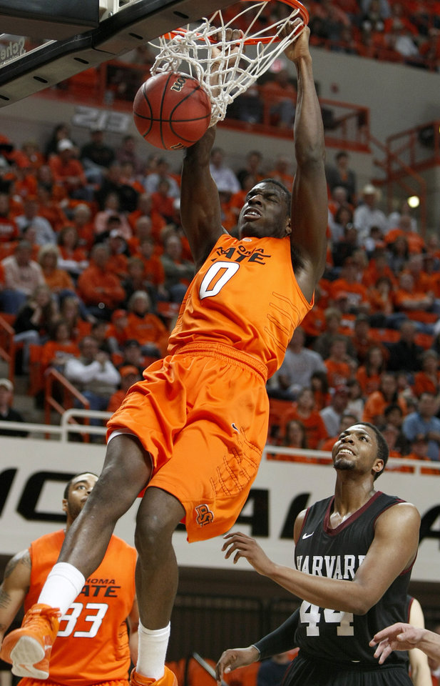 Oklahoma State\'s Jean-Paul Olukemi (0) dunks the ball as Harvard\'s Keith Wright (44) and Oklahoma State\'s Marshall Moses (33) watche during a first-round NIT college basketball game between Oklahoma State University (OSU) and Harvard at Gallagher-Iba Arena in Stillwater, Okla., Tuesday, March 15, 2011. Photo by Bryan Terry, The Oklahoman
