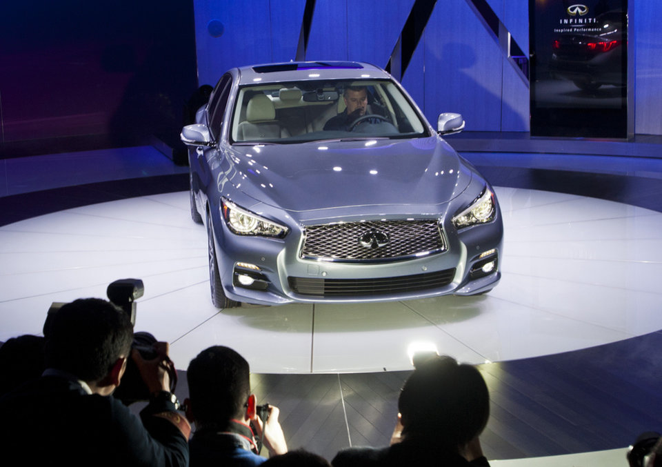 Photo - The Infiniti Q50 sedan is introduced at the North American International Auto Show, Monday, Jan. 14, 2013, in Detroit, Mich. (AP Photo/Tony Ding)