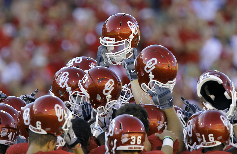 Photo - Oklahoma huddles up before the start of the game against Utah State in the college football game between the University of Oklahoma Sooners (OU) and Utah State University Aggies (USU) at the Gaylord Family-Oklahoma Memorial Stadium on Saturday, Sept. 4, 2010, in Norman, Okla.   Photo by Chris Landsberger, The Oklahoman