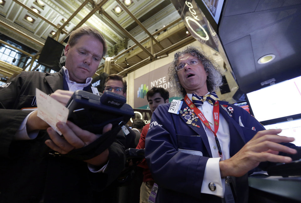 Photo - Trader Thomas McCauley, left, and specialist Donald Civitanova work on the floor of the New York Stock Exchange, Friday, May 23, 2014. Stocks inched higher early Friday in quiet trading ahead of the Memorial Day weekend.  (AP Photo/Richard Drew)