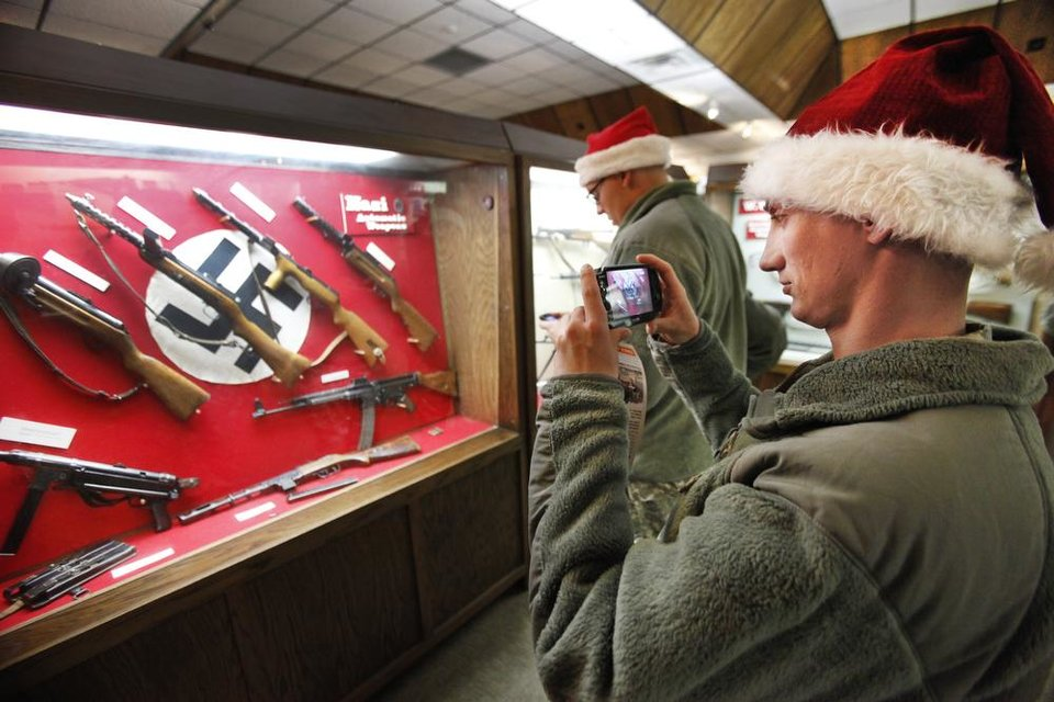 New recruit PFC James Clark takes a photo of one of the displays at the 45th Infantry Museum during Soldiers Day Out, Friday, December 21, 2012. Edmond/North OKC Blue Star Mothers will be taking the soldiers who can't go home for Christmas around the metro for a day of fun. Photo By David McDaniel/The Oklahoman