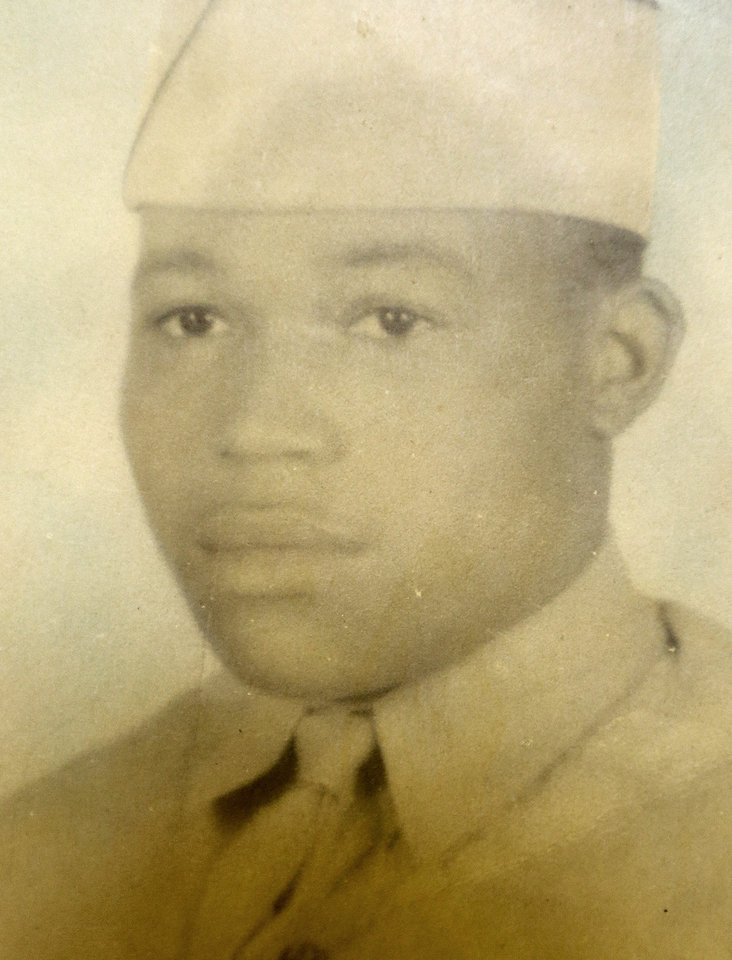 Photo - In this photograph provided by Carol Wilkins, Willie Wilkins is seen at the age of 21 during an event at Newark City Hall in which his dog tags, which he lost while serving in a U.S. Army Quartermaster Truck Company in the invasion of Southern France in August 1944, were returned to him, Wednesday, May 8, 2013, in Newark, N.J. The dog tags were lost in 1944 and were found by Anne-Marie Crespo, a resident of Istres, who was digging in her garden in 2001. The event, which was held as a surprise for Wilkins, 90, also marked the 68th anniversary of V-E Day, the end of World War II in Europe. (AP Photo/Courtesy of  Carol Wilkins)