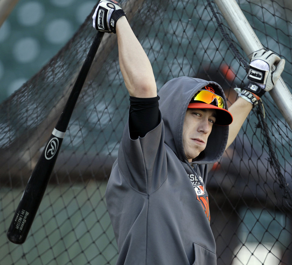 San Francisco Giants pitcher Tim Lincecum warms up before Game 2 of the National League division baseball series against the Cincinnati Reds in San Francisco, Sunday, Oct. 7, 2012. (AP Photo/Eric Risberg)