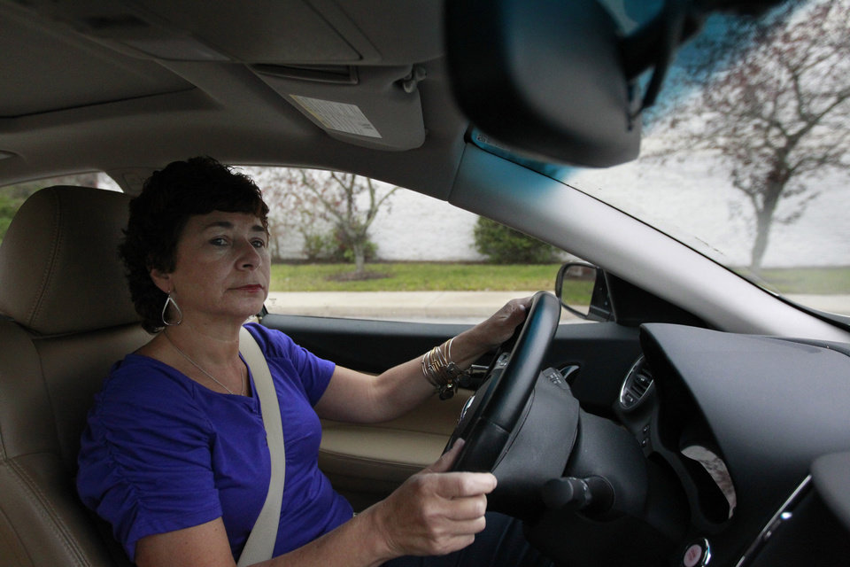 Photo -   In this Thursday, Oct. 4, 2012 photo retiree Jamie Reilly, of North Providence, R.I., drives her car in North Attleboro, Mass. Reilly left her job as a secretary at age 50, thinking her 30 years of state employment would mean good benefits during her later years. But now she said she may be forced to re-enter the workforce at age 55 because the state has put off pension increases. (AP Photo/Steven Senne)