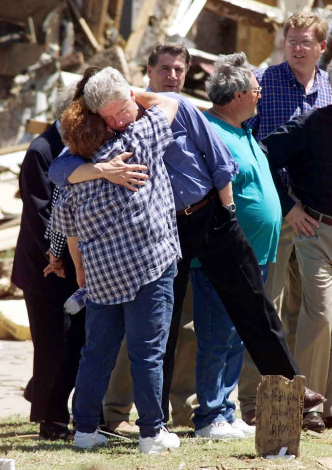 Tornado damage tour: President Bill Clinton gives tornado victim Sherrill Evett a hug.