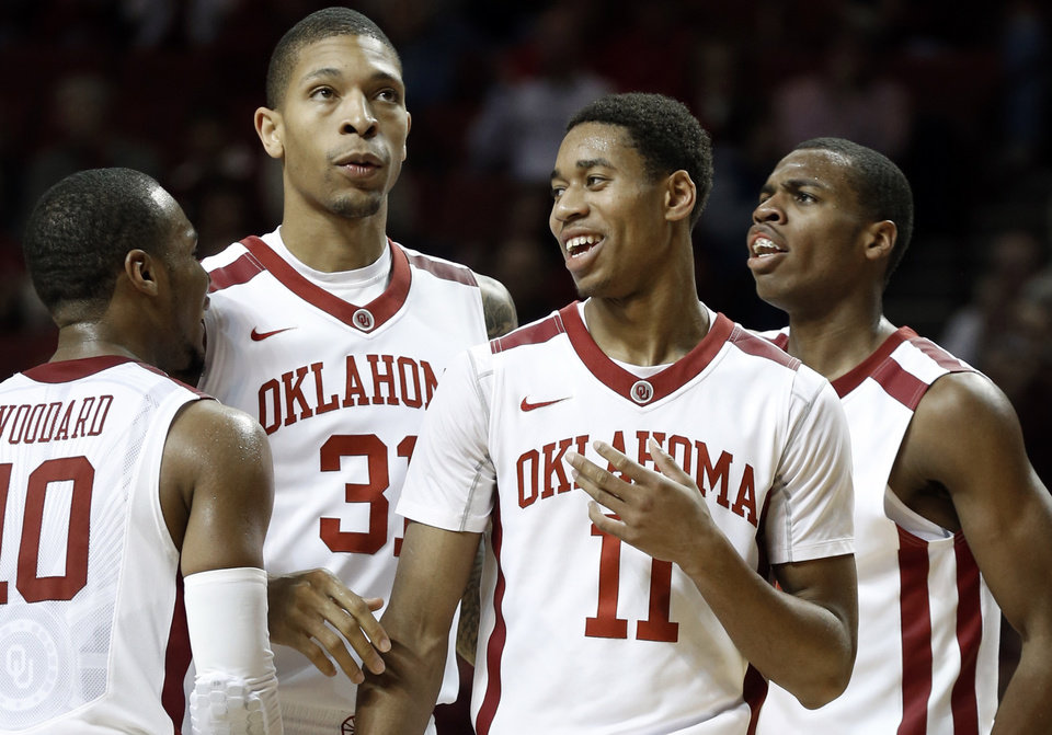 Oklahoma Sooner\'s Jordan Woodard (10), D.J. Bennett (31), Isaiah Cousins (11) and Buddy Hield (24) react to play as the University of Oklahoma Sooners (OU) men defeat the Iowa State Cyclones (ISU) 87-82 in NCAA, college basketball at The Lloyd Noble Center on Saturday, Jan. 11, 2014 in Norman, Okla. Photo by Steve Sisney, The Oklahoman