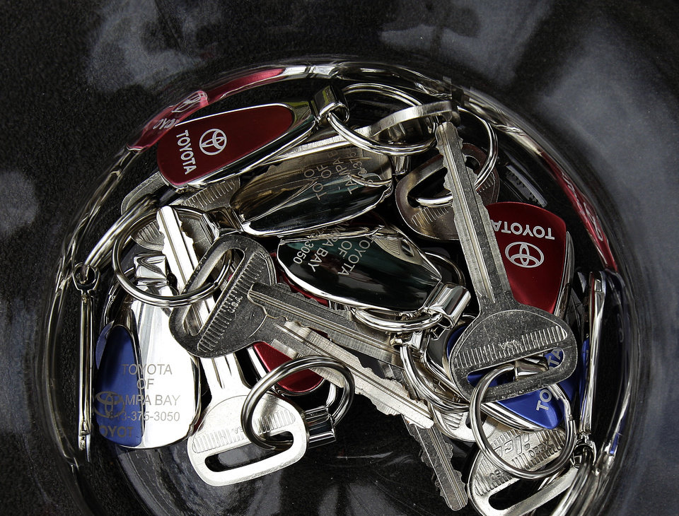 FILE - In this photo taken June 25, 2011, file photo, Toyota keys sit in a fish bowl at the Toyota of Tampa Bay dealership in Tampa, Fla. A plaintiffs' attorney on Wednesday, Dec. 26, 2012, says Toyota Motor Corp. has reached a settlement in a case involving hundreds of lawsuits over accelerations problems. Steve Berman said Wednesday the settlement, which still needs a federal judge's approval, was worth more than $1 billion and is the largest settlement in U.S. history involving automobile defects.  (AP Photo/Chris O'Meara, File)
