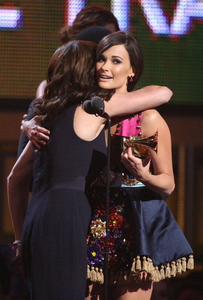 Photo - Martina McBride, left, embraces Kacey Musgraves after presenting her with the award for best country album for