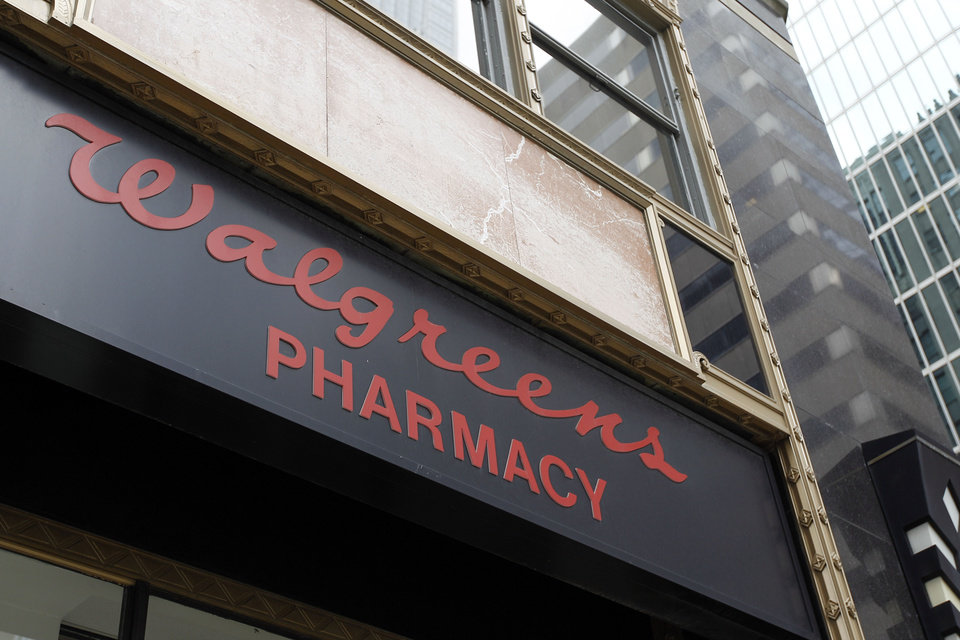 FILE - In this June 20, 2011 file photo, a Walgreens pharmacy sign is displayed in Philadelphia. The nation\'s largest drugstore chain says it earned $353 million, or 39 per share, in its 2012 fiscal fourth quarter. (AP Photo/Matt Rourke, File)