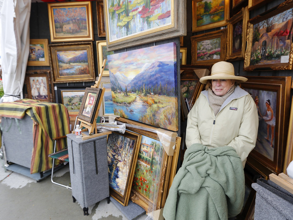 Tulsa artist J. Matzdorf keeps warm in her booth at the Festival of the Arts in Oklahoma City , Tuesday April 23, 2013. Photo By Steve Gooch, The Oklahoman