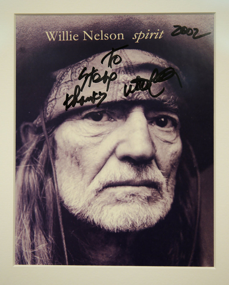 Photo -  A signed photo of Willie Nelson has a home in the office of Dr. Stephen Prescott at the Oklahoma Medical Research Foundation. [PHOTO PROVIDED]