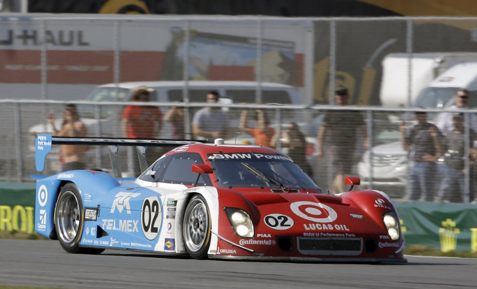 Photo - Scott Dixon, of New Zealand, drives the Ganassi Racing BMW Riley through the infield course during the Grand-Am Series Rolex 24 hour auto race at Daytona International Speedway, Sunday, Jan. 27, 2013, in Daytona Beach, Fla. (AP Photo/John Raoux)