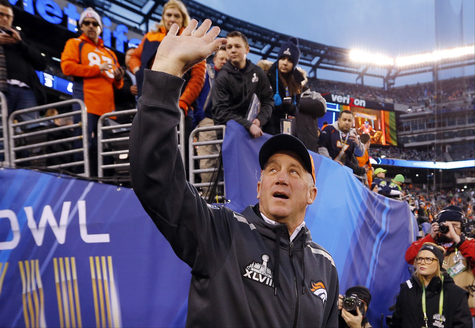 Photo - Denver Broncos head coach John Fox waves to the crowd as he walks on the field before the NFL Super Bowl XLVIII football game against the Seattle Seahawks Sunday, Feb. 2, 2014, in East Rutherford, N.J. (AP Photo/Paul Sancya)