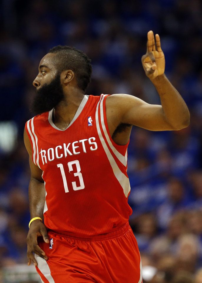 Photo - Houston's James Harden (13) celebrates a three-point shot during Game 1 in the first round of the NBA playoffs between the Oklahoma City Thunder and the Houston Rockets at Chesapeake Energy Arena in Oklahoma City, Sunday, April 21, 2013. Photo by Sarah Phipps, The Oklahoman