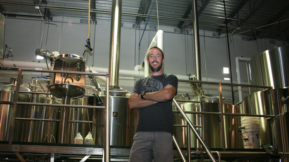 Photo -  Coop Ale Works co-founder Daniel Mercer is shown at the craft beer maker's Oklahoma City brewery. [Photo by Sarah Phipps, The Oklahoman Archives]