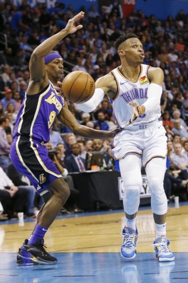 Photo -  Oklahoma City's Russell Westbrook (0) passes away from Los Angeles' Rajon Rondo (9) in the second quarter during an NBA basketball game between the Los Angeles Lakers and the Oklahoma City Thunder at Chesapeake Energy Arena in Oklahoma City, Tuesday, April 2, 2019. Photo by Nate Billings, The Oklahoman