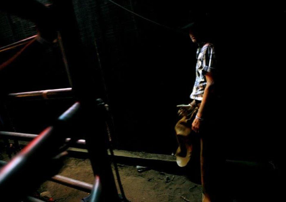 Photo -  A bullrider waits for his turn during a night at Club Rodeo in Oklahoma City last Summer.