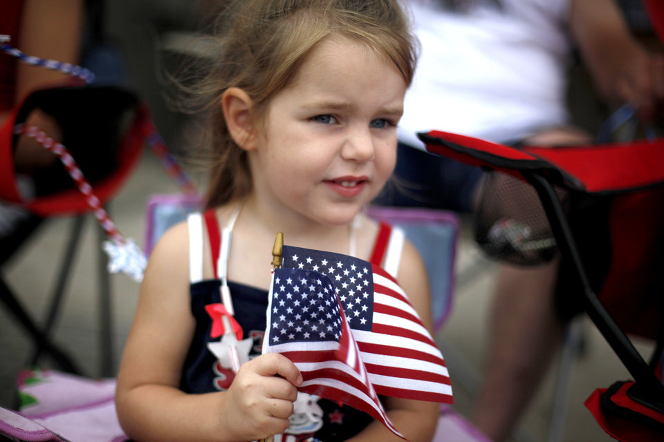 Kaylee Choate waves a flag during the LibertyFest Parade, Saturday, July 3, 2010, in downtown Edmond, Okla. Photo by Sarah Phipps, The Oklahoman