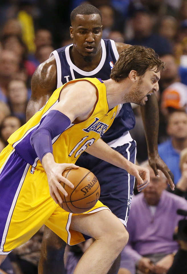 Photo - LA's Pau Gasol (16) takes the ball past Oklahoma City's Kendrick Perkins (5) during an NBA basketball game between the Los Angeles Lakers and the Oklahoma City Thunder at Chesapeake Energy Arena in Oklahoma City, Friday, Dec. 13, 2013. Photo by Nate Billings, The Oklahoman