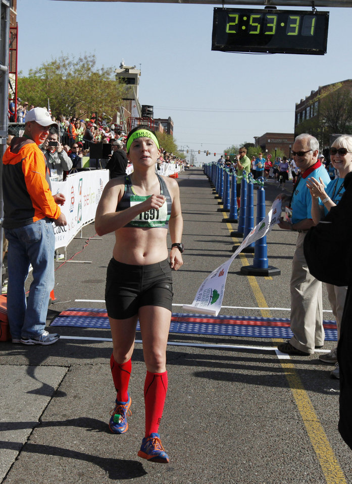 Photo - McKale Davis crosses the finish line as the female winner in the Oklahoma City Memorial Marathon in Oklahoma City, Sunday, April 28, 2013,  By Paul Hellstern, The Oklahoman