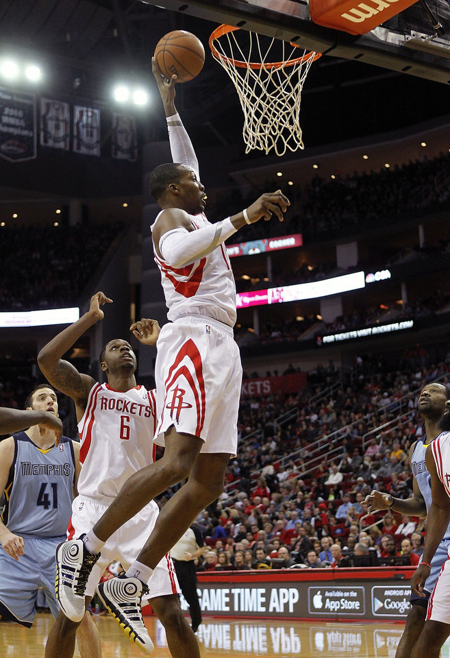 Photo - Houston Rockets forward Dwight Howard grabs a rebound as Terrence Jones (6) watches during the first half of an NBA basketball game against the Memphis Grizzlies on Thursday, Dec. 26, 2013, in Houston. (AP Photo/Bob Levey)