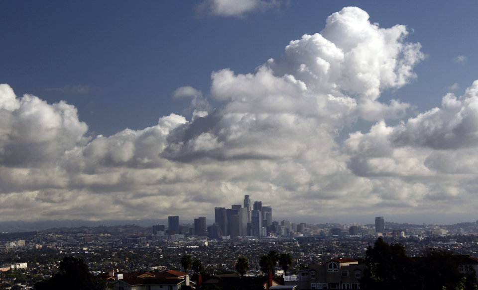 Photo - Storm clouds are shown over downtown Los Angeles Thursday Feb. 27, 2014. Southern California got an overnight soaking Thursday as residents prepared for a second, more powerful storm that could bring heavier rain and prompted fears of mudslides in communities along fire-scarred foothills.(AP Photo/Nick Ut)