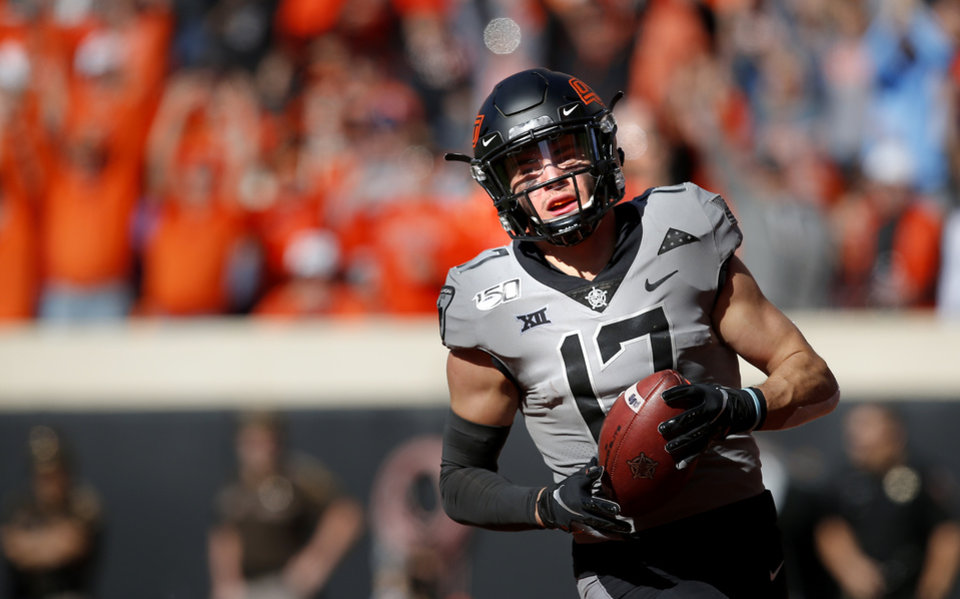Photo - Oklahoma State's Dillon Stoner (17) catches a touchdown pass in the second quarter during the college football game between the Oklahoma State University Cowboys and the Kansas Jayhawks at Boone Pickens Stadium in Stillwater, Okla., Saturday, Nov. 16, 2019. OSU won 31-13. [Sarah Phipps/The Oklahoman]