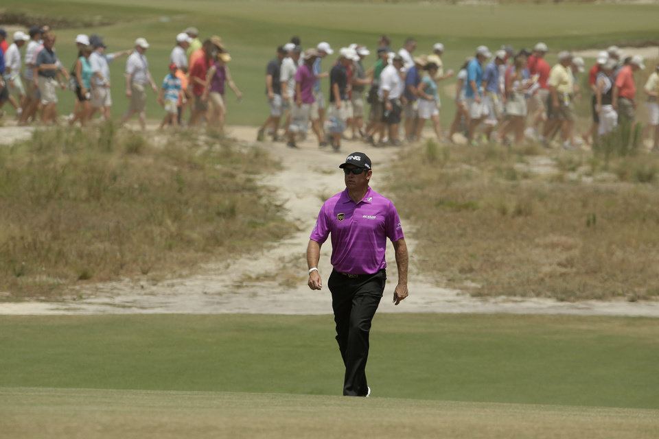 Photo - Lee Westwood, of England, walks down the 18th fairway hole during a practice round for the U.S. Open golf tournament in Pinehurst, N.C., Wednesday, June 11, 2014. The tournament starts Thursday. (AP Photo/Charlie Riedel)